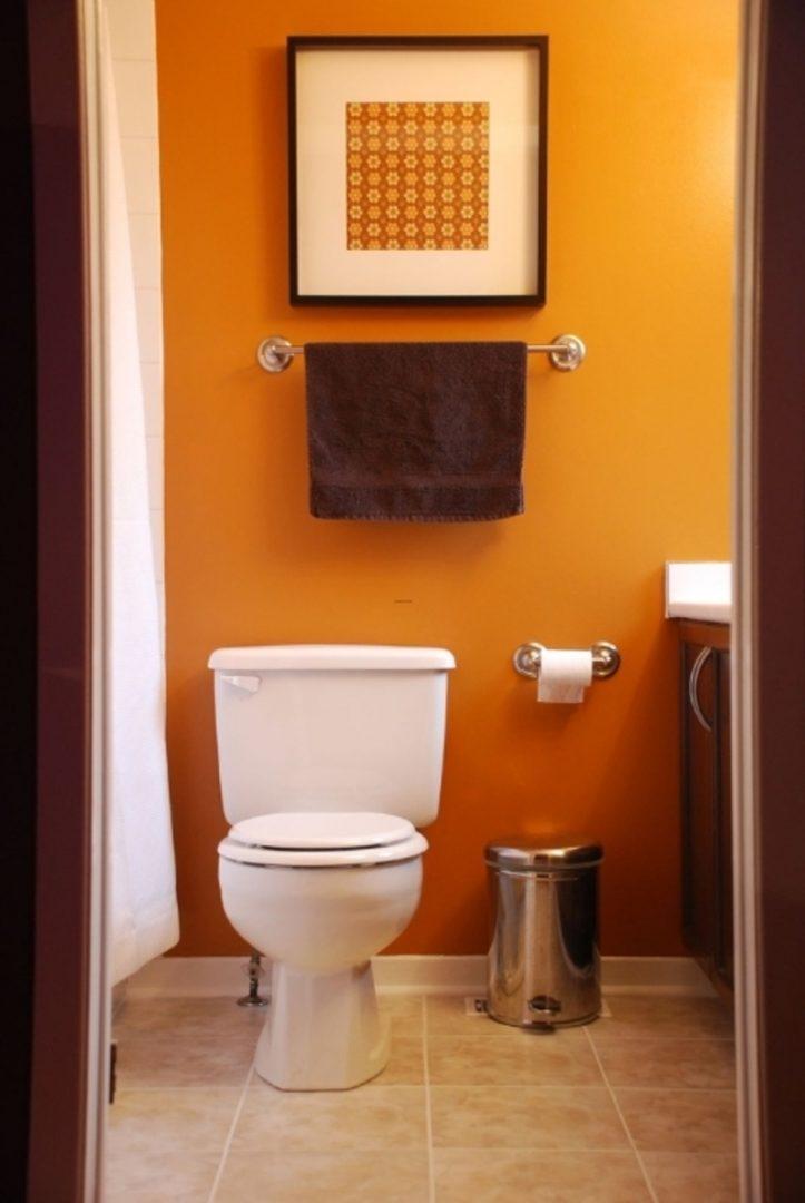 Galer a de im genes decoraci n en color naranja for Great un bano con paredes en naranja de